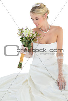 Bride with eyes closed smelling flower bouquet