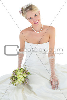 Portrait of happy bride holding rose bouquet
