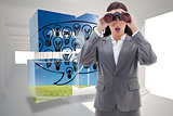 Composite image of surprised businesswoman looking through binoculars