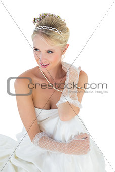 Smiling bride thinking over white background