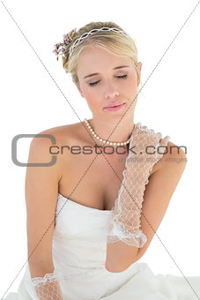 Bride with eyes closed touching shoulder