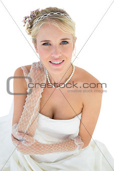Smiling bride with hand on shoulder