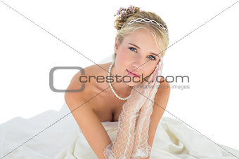 Bride with hands clasped over white background