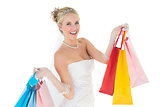 Bride holding shopping bags over white background
