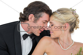 Bride and groom with head to head over white background