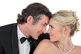 Smiling bride and groom with head to head