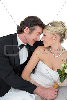 Attractive bride and groom with head to head