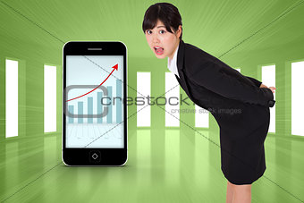 Composite image of surpised businesswoman bending