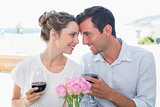 Couple with wine glasses looking at each other