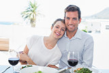 Loving couple with wine glasses at lunch table