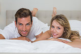 Close-up portrait of a loving couple lying in bed
