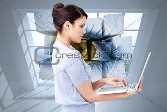 Composite image of confident businesswoman using a laptop