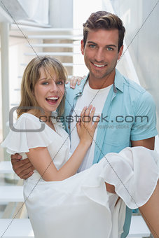 Portrait of a smiling man carrying woman