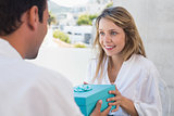 Man giving happy woman a gift box