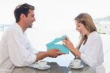 Man giving happy woman gift box