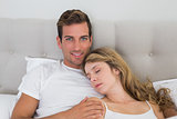 Close-up of a relaxed young couple in bed