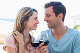 Loving young couple toasting wine glasses