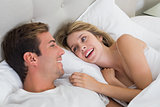 Relaxed young couple resting in bed
