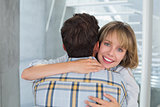Loving young woman embracing man