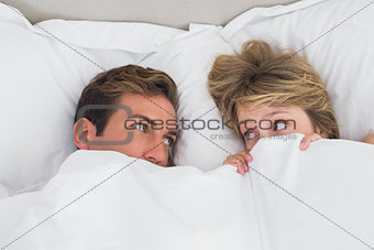 Relaxed young couple in bed