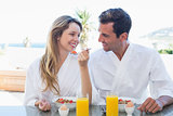 Smiling couple having breakfast