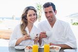 Smiling young couple having breakfast