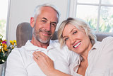 Happy mature couple relaxing on sofa