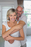 Mature man embracing smiling woman