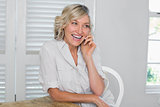 Cheerful mature woman using mobile phone