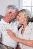 Relaxed mature couple with head to head and eyes closed