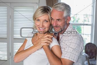 Mature man embracing a happy woman