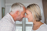 Mature couple looking at each other at home