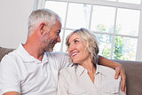 Relaxed mature couple looking at each other