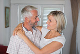 Smiling woman embracing mature man