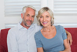 Portrait of smiling mature couple on couch