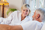 Mature couple lying in bed