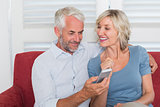Mature couple reading text message