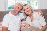 Portrait of a relaxed mature couple sitting on sofa