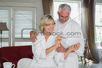Mature couple with bills at home