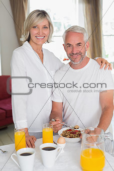 Mature couple having breakfast at home