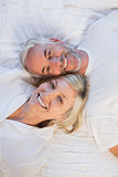 High angle portrait of happy mature couple lying in bed