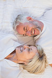 High angle portrait of a happy mature couple in bed