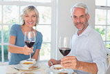 Mature couple with wine glasses and food