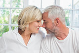 Close-up of a relaxed mature couple with eyes closed at home