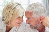 Close-up of a happy mature couple in bed