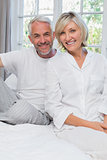 Portrait of a happy mature couple in bed