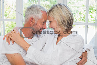 Loving happy mature couple with arm around