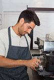 Waiter preparing espresso at coffee shop