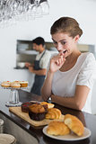 Woman looking at sweet food at coffee shop
