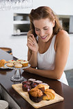Woman looking at sweet food at coffee shop